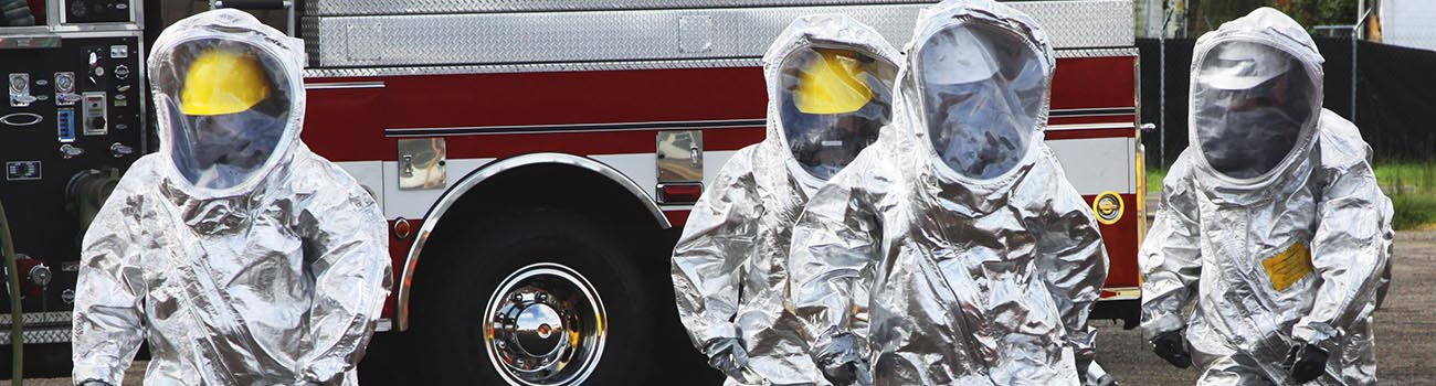 Emergency Response Team in HAZMAT suites approaching investigation